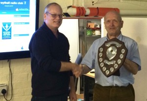 Chairman Mike G4VPD receives the trophy from Martyn G3UKV